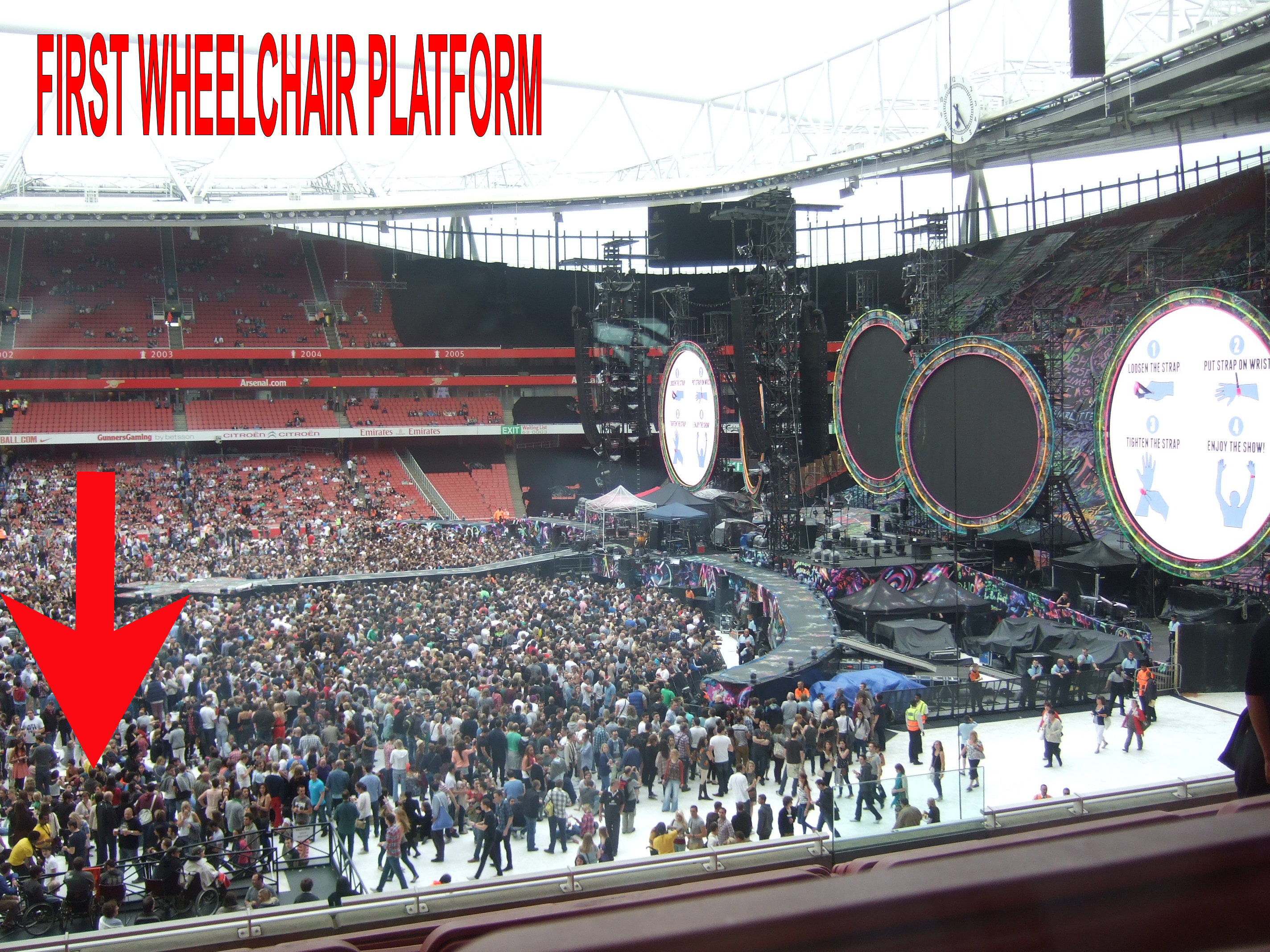 Photo showing front section of arena, with the stage and the front of the wheelchair platform